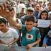 Pengungsi dari berbagai negara berunjuk rasa di luar kantor UNHCR di Jakarta pada 20 Agustus 2019, mengecam kebijakan Australia yang membekukan penerimaan pengungsi.
