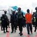 Densus 88 Antiteror mengawal Upik Lawanga (Taufik Bulaga), seorang pentolan kelompok teror Jemaah Islamiyah, setibanya militan yang diduga menjadi dalang beberapa aksi teror di Indonesia itu di Bandara Soekarno-Hatta di Tangerang pada 16 Desember 2020, setelah diterbangkan dari Lampung dimana dia ditangkap. Kelompok militan yang ditangkap pada Jumat (26/2/2021) di sejumlah wilayah di Jawa Timur disebut memiliki kaitan dengan Upik.