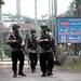 Polisi berpatroli di sekeliling Lembaga Pemasyarakatan Gunung Sindur di Bogor pada 22 Jan 2019, dimana Abu Bakar Bashir, ulama yang terkenal dengan pandangan radikalnya dan mantan pemimpin Jemaah Islamiyah, menjalani masa hukuman penjaranya.